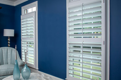 Heritage Shutters in a Blue Living Room